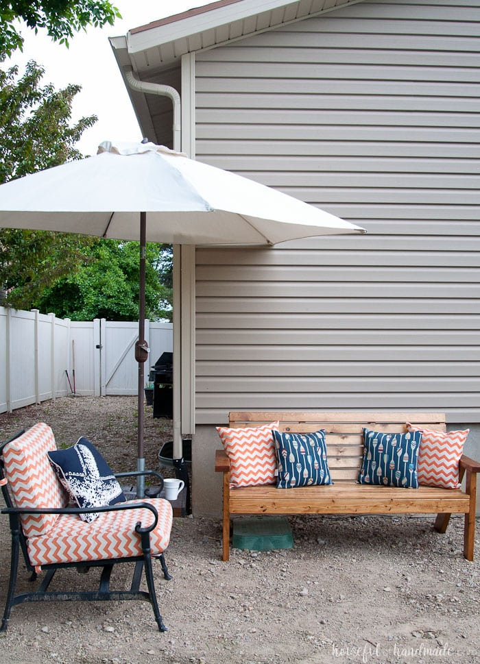 Get ready to spend time outside with these Slatted Outdoor Sofa Build Plans. This outdoor seating is beautifully built with mostly 2x4s, but looks much more expensive. It features slatted seat that can be used with or without sofa cushions. The beautiful lines of the legs are inspired by classic Adirondack chairs. Housefulofhandmade.com | Free woodworking plans | Kreg Pocket Holes | Outdoor Bench | DIY Patio Furniture | Rustic Outdoor Sofa | DIY Outdoor Sofa