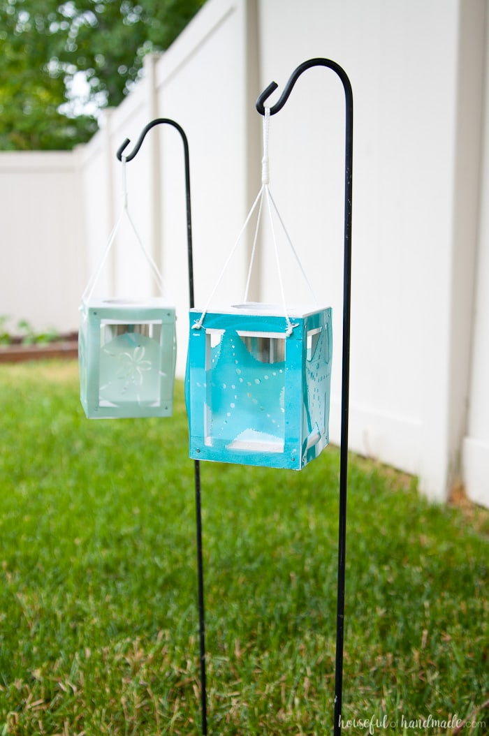 Create beautiful beach themed decor for the backyard with scrap wood, cheap solar path lights and your Silhouette Cameo. These coastal solar lantern decor will give beautiful lighting to the warm summer evenings. A fun and easy DIY for summer decorating. Housefulofhandmade.com | Silhouette Creators Challenge | Silhouette Crafts | Outdoor Crafts | DIY Solar Lanterns | Decorative Solar Lights