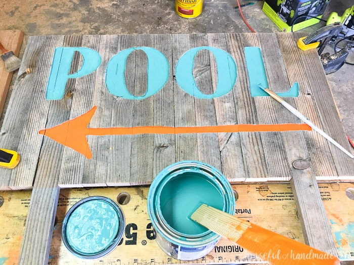 Create the perfect outdoor decor for summer with this DIY wood sign with a router. Using reclaimed wood, the 3D pool sign is perfect for your next party! Housefulofhandmade.com | Router Sign | Reclaimed Wood Sign | How to Make a Sign with a Router | Scrap Wood Projects | Summer Sign | Outdoor Sign