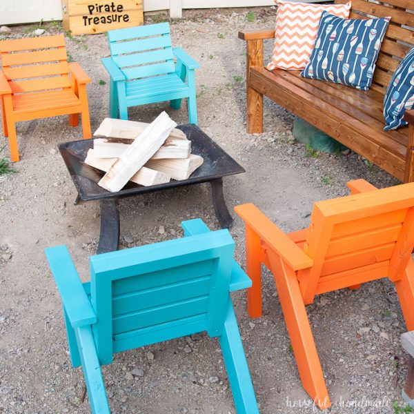 Blue and orange kids patio chairs around a fire pit with a matching sofa. Housefulofhandmade.com
