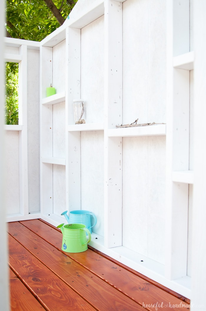 Create the perfect outdoor space for your kids this summer. Build a DIY playhouse for hours of imaginative play. This week we share the plans for the walls, including time and cost breakdown. Follow along at Housefulofhandmade.com | How to Build a Playhouse | DIY Swing Set | Small Playhouse | Playhouse Build Plans