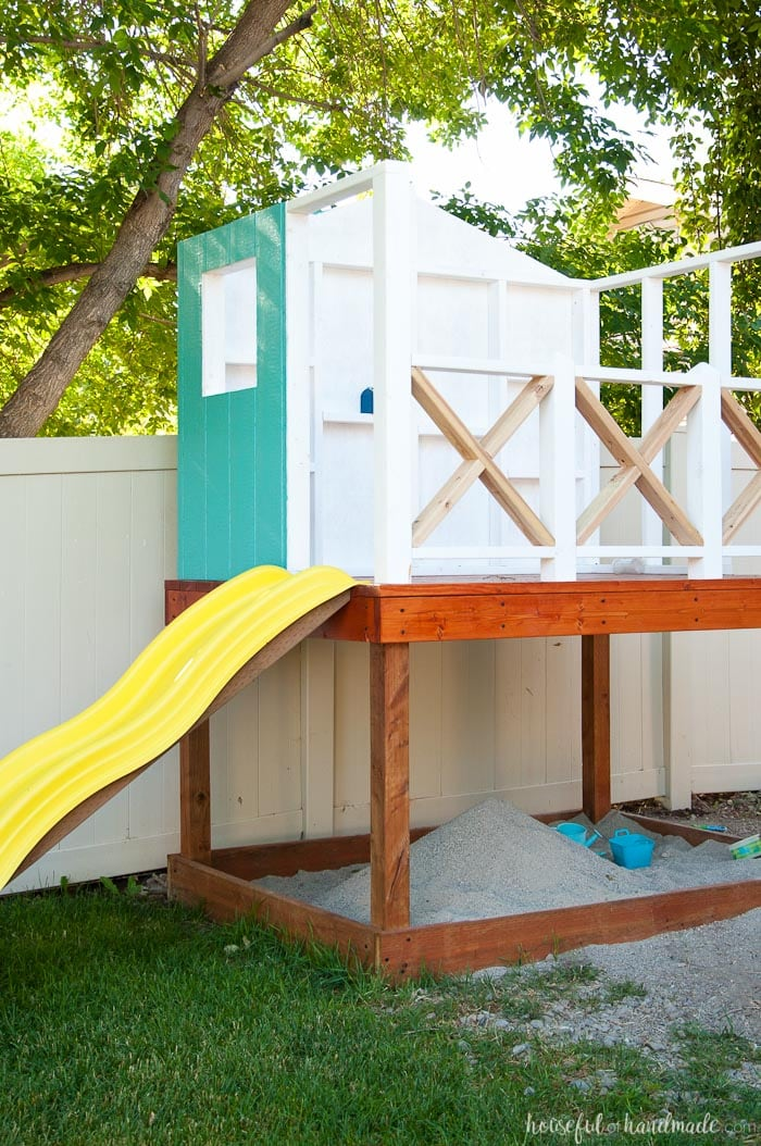 Our DIY Playhouse is coming along! This week we tackled the playhouse railing. The beautiful X railing is perfect for the cute cottage playhouse. See how we are building the playhouse step-by-step including free build plans and time/cost breakdown. Housefulofhandmade.com | DIY Playhouse | Playhouse Build Plans | DIY Swing Set | How to Build a Playhouse | DIY Sandbox | How to Build an X Railing