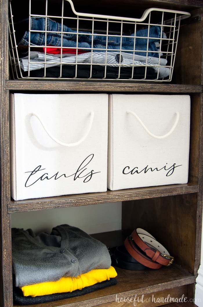 Covered cardboard boxes make inexpensive closet storage without sacrificing style. See the entire walk in closet remodel at Housefulofhandmade.com