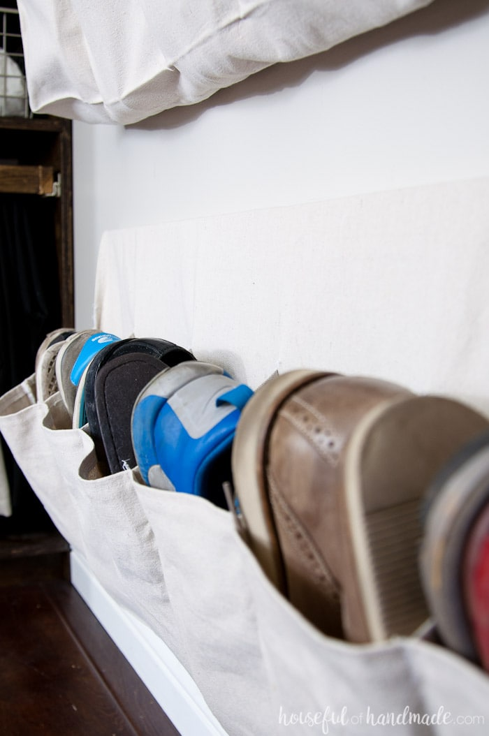 Sew shoe storage pockets out of drop cloth to keep all those shoes off the floor. See how we transformed our walk in closet into a dressing area on a budget. Housefulofhandmade.com