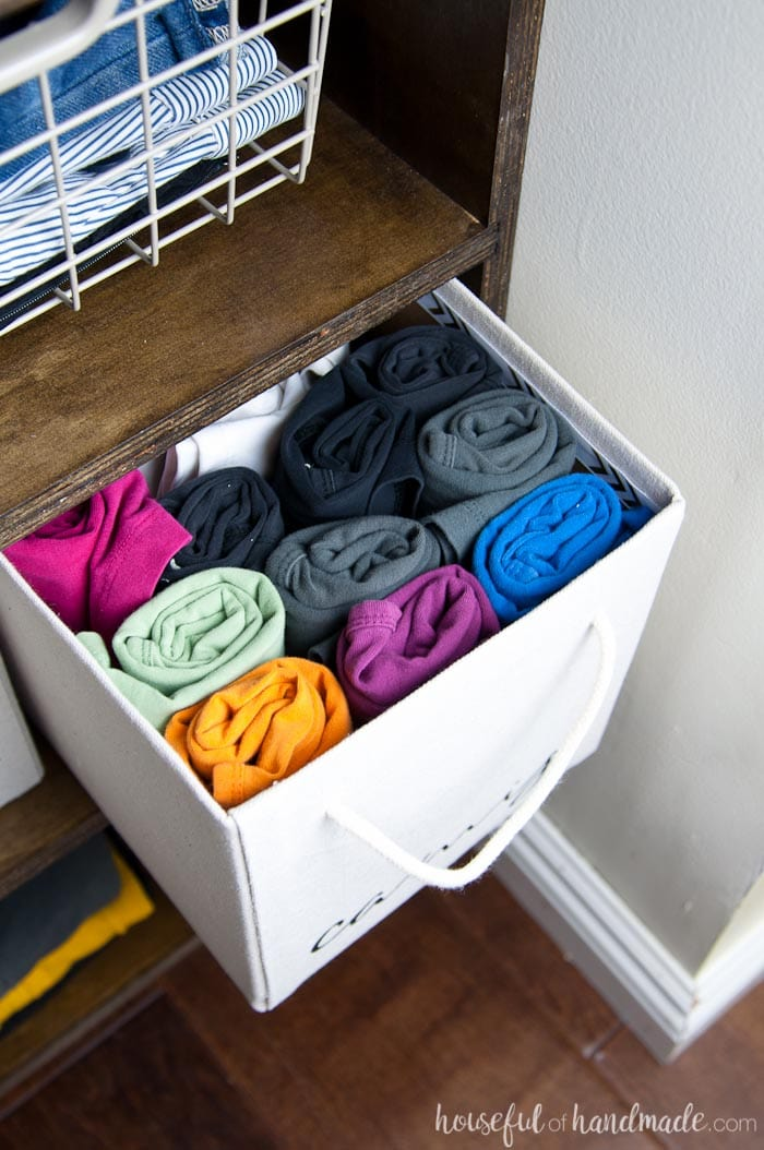 Learn how to easily store small clothing items. See the entire budget walk in closet reveal at Housefulofhandmade.com