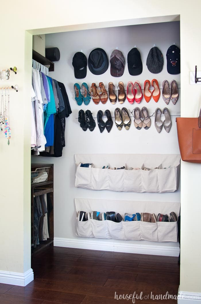 Drop cloth shoe storage on the wall with cheap high heel storage above it.