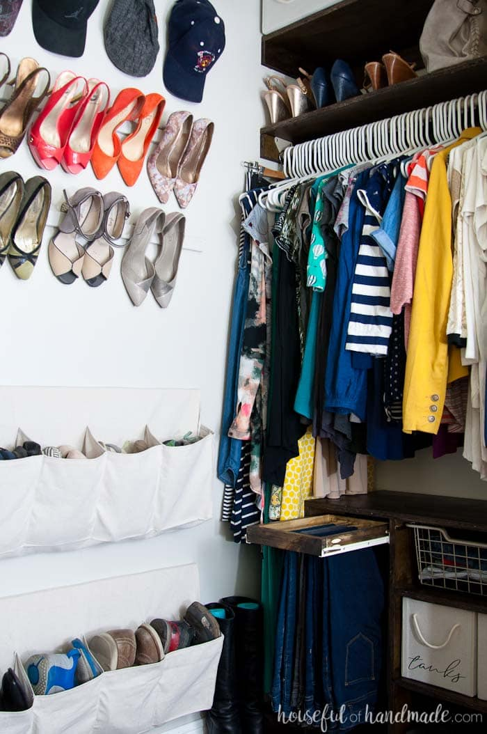 The perfectly organized and beautiful walk in closet only cost $100. Includes lots of clothing and shoe storage solutions. Housefulofhandmade.com