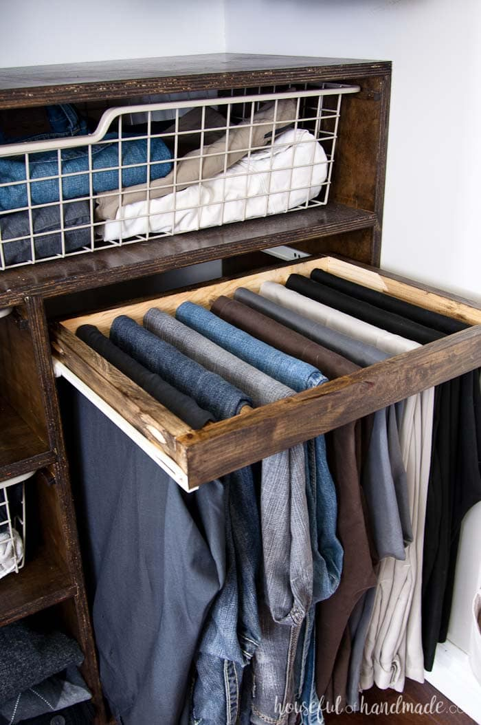For just a few dollars, build a pull out rack to hang your pants. Our walk in closet reveal includes tons of closet storage organization ideas on a budget. Housefulofhandmade.com