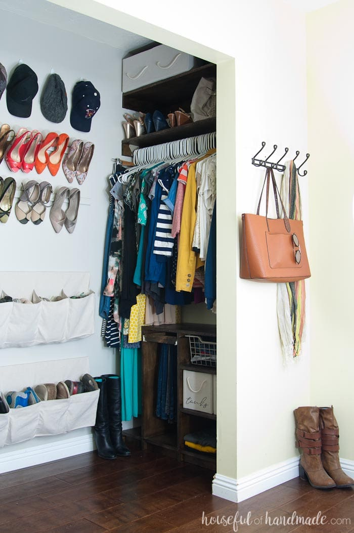 We reconfigured the entire layout of out tiny master bedroom closet and gained tons of storage. See how we turned our closet into a beautiful walk in closet for only $100. Housefulofhandmade.com
