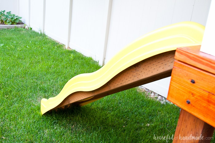 Our DIY playhouse is almost done! This week we are sharing all the details on how we installed the slide and climbing wall to make the playhouse into a kids dream play area. Includes the build plans and cost breakdown for the whole project. Housefulofhandmade.com | How to build a playhouse | DIY swing set | Kids Playhouse | Free Build plans | How to Install a slide