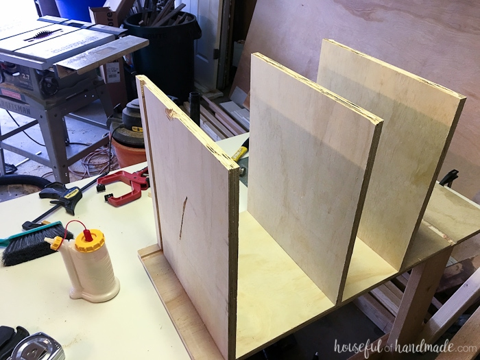 All the shelves in one side of the cabinet glued into the grooves.