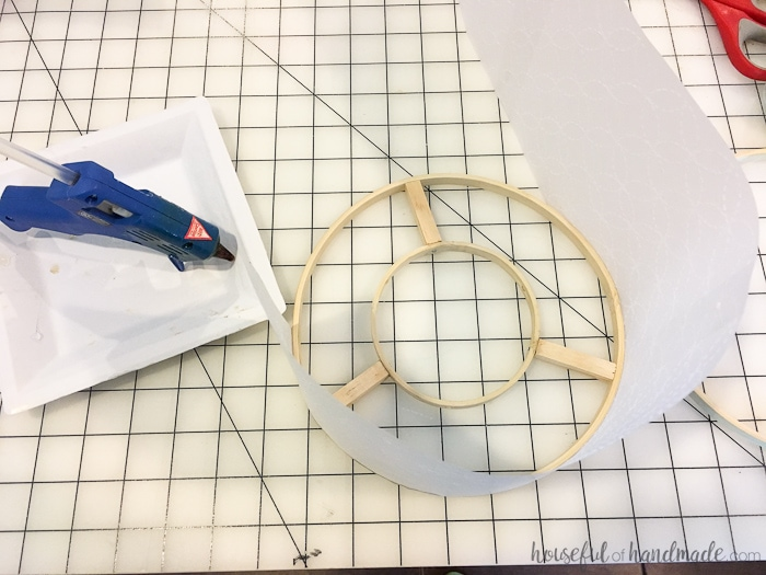 Use vellum and embroidery hoops to upcycle an old light fixture. Create a beautiful drum ceiling light fixture. Housefulofhandmade.com
