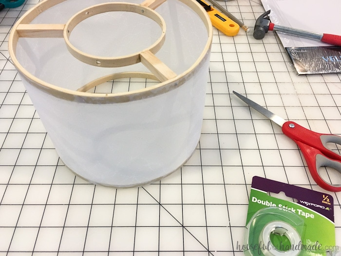 Update your lighting with this easy DIY drum ceiling light. Create a beautiful light fixture for less than $15. Housefulofhandmade.com