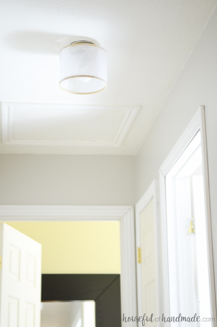 Create a beautiful drum ceiling light from an old globe light fixture. This easy DIY is perfect for adding style to any home on a budget. Housefulofhandmade.com