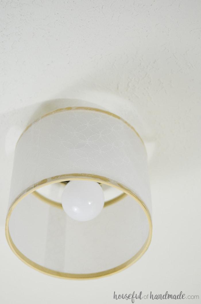 Create a beautiful new light fixture from an old light. Create a beautiful drum ceiling light for just a few dollars. Housefulofhandmade.com