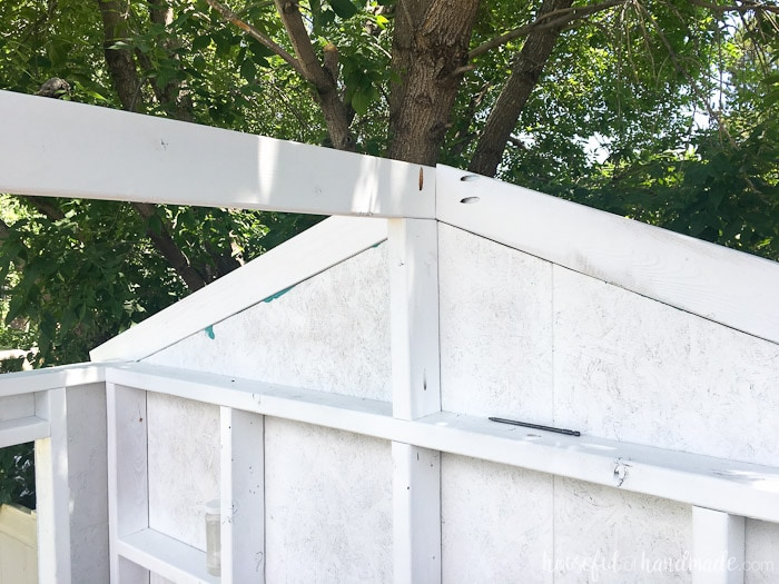 Create a DIY playhouse for your backyard this summer. See how to roof it with corrugated panels on Housefulofhandmade.com