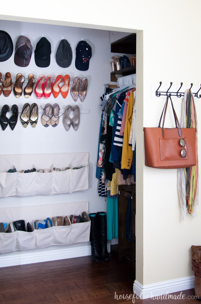 Organize your closet with these hanging shoe storage ideas. Drop cloth shoe pockets and hanging high heel storage are perfect for a dream closet. Housefulofhandmade.com