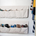 Turn your closet into an organized dressing area with this hanging shoe storage. Now all the shoes are off the floor and the closet is open and organized. Housefulofhandmade.com