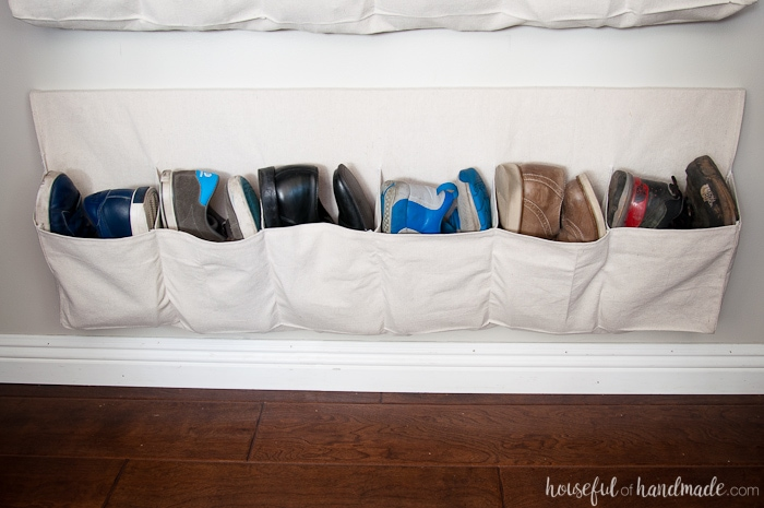 This drop cloth hanging shoe storage was made for less than $10 (for 2) and are the perfect way to keep all your shoes off the floor. Housefulofhandmade.com