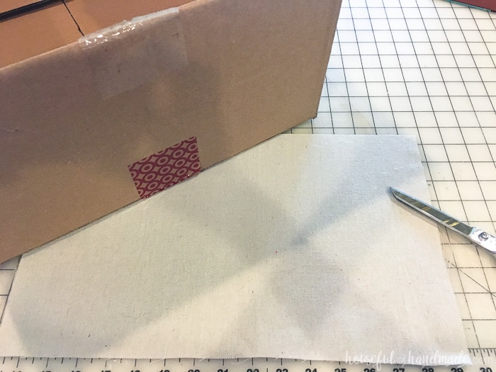 Turn your old cardboard boxes into beautiful storage boxes. Learn how to make these drop cloth storage boxes for only a couple dollars. Housefulofhandmade.com