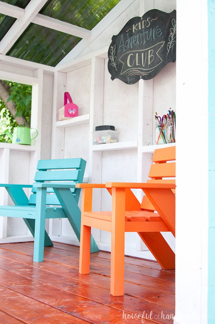 The bright colored kids patio chairs turn this outdoor playhouse into the perfect clubhouse. See the entire build at Housefulofhandmade.com