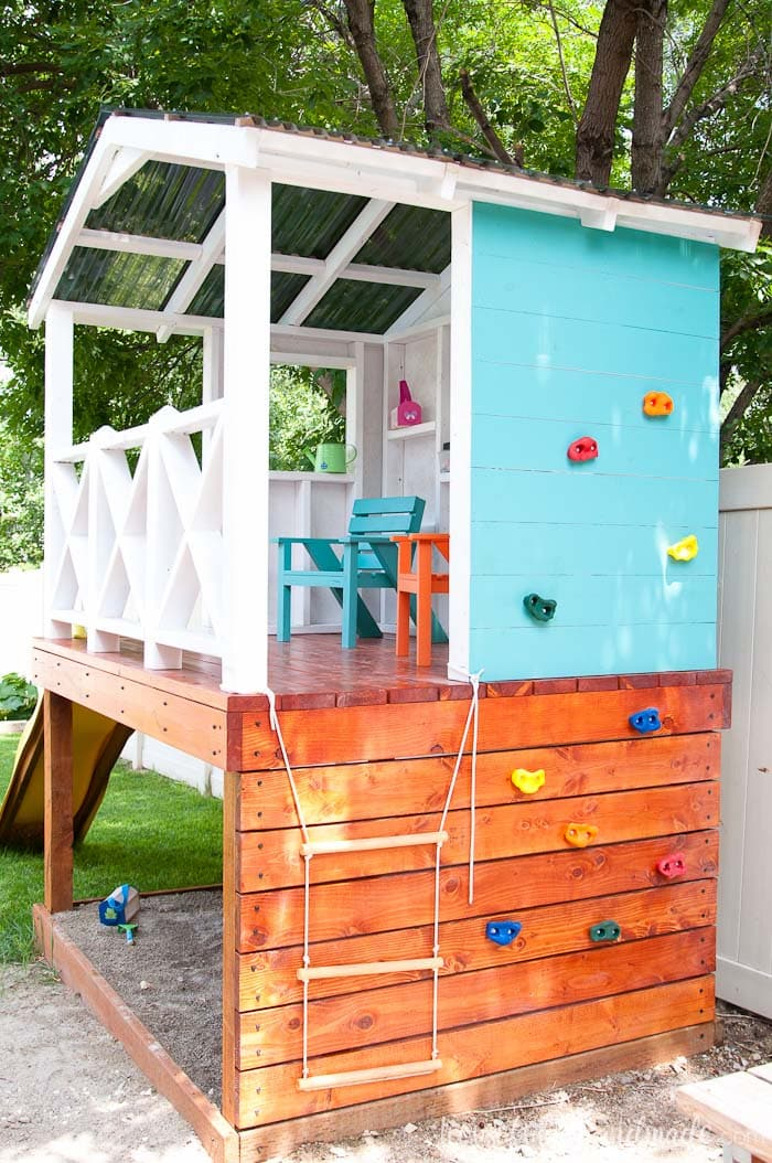 Since the yard is small, we are utilizing every inch of space by turning the wall of the outdoor playhouse into a climbing wall for more fun! Housefulofhandmade.com
