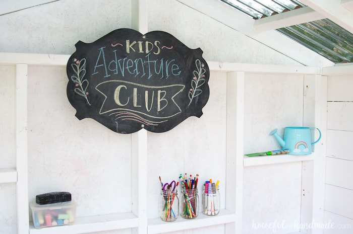 A chalkboard is the perfect addition to this outdoor playhouse. Housefulofhandmade.com