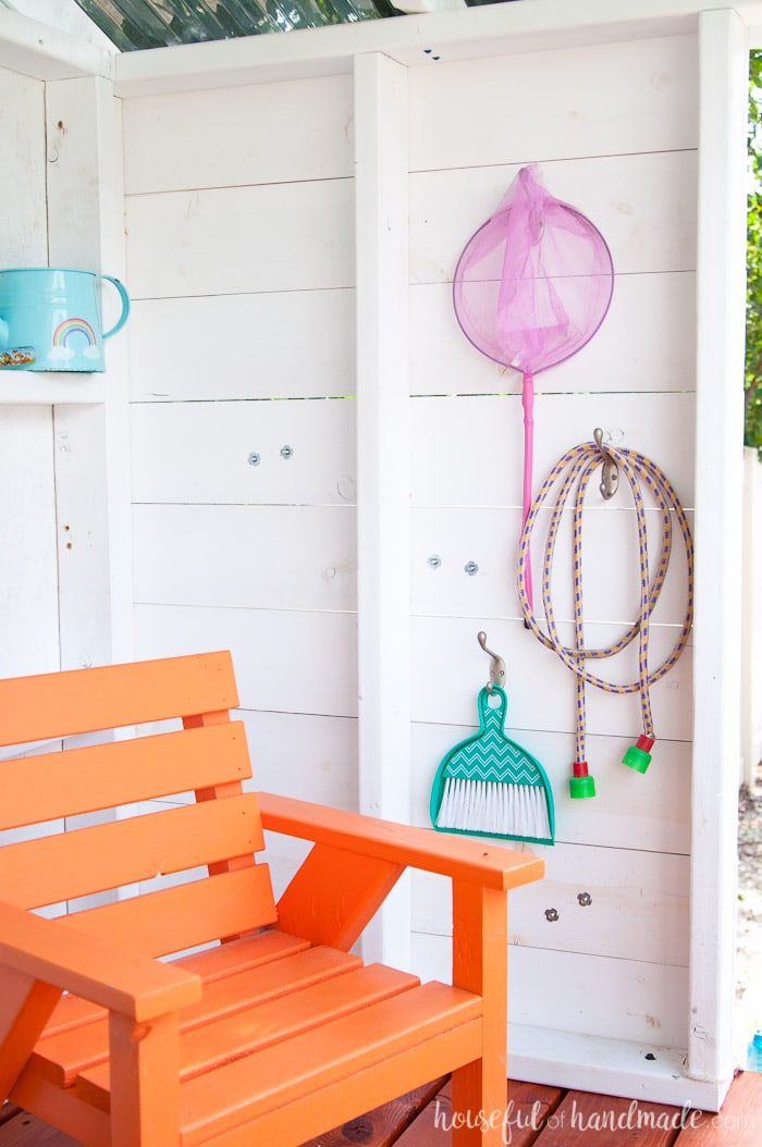 Create an area for the kids creative play. This wooden outdoor playhouse is perfect for stretching the kids imagination and getting them off the screens all year long. Housefulofhandmade.com