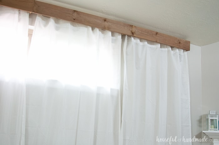 Use a rustic window cornice box to add balance to asymmetrical windows. Learn how to make a window cornice box at Housefulofhandmade.com