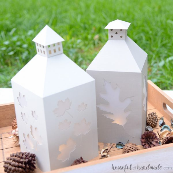 Create stunning fall decor on a budget with these easy DIY candle lanterns. The falling leaves are perfect to add a touch of autumn to your home. Housefulofhandmade.com