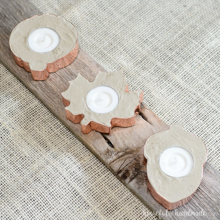 Learn how to make copper tea light holders out of concrete and cookie cutters. Perfect for decorating for any season. Housefulofhandmade.com