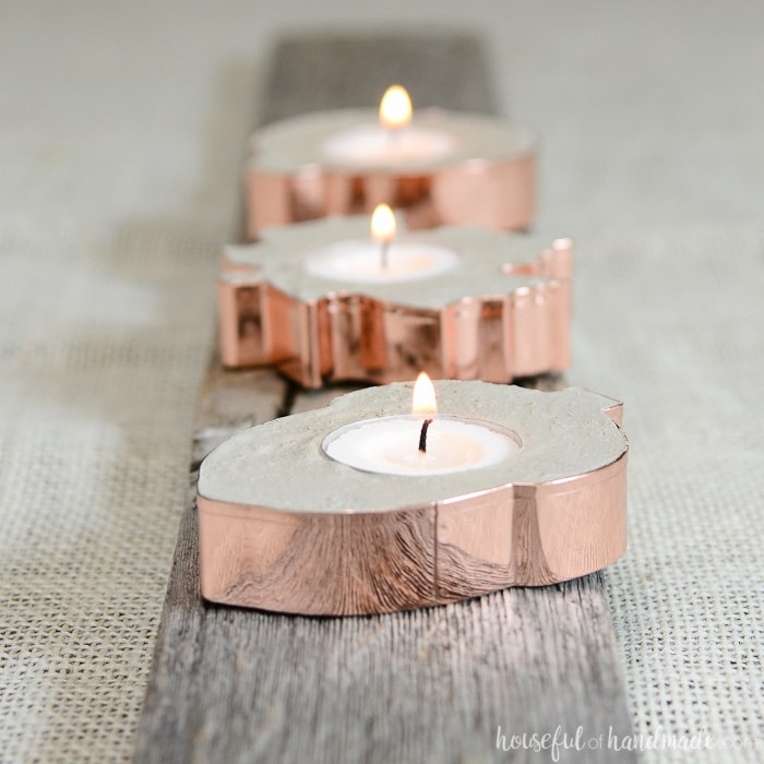 Create the perfect rustic fall decor with these easy to make copper candle holders. Concrete and copper are beautiful for fall! Housefulofhandmade.com