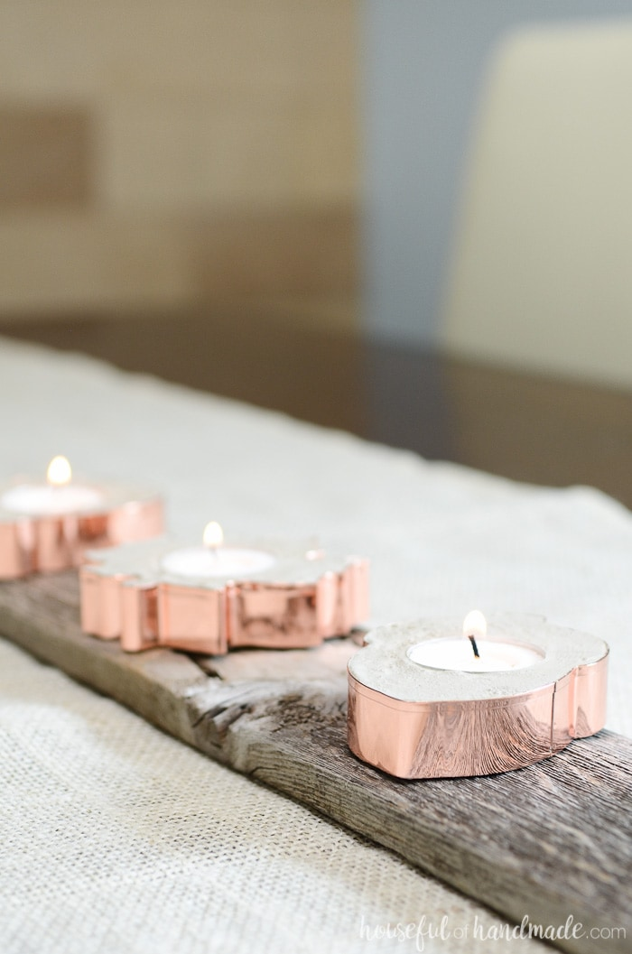 Copper cookie cutters take on a new life. Turn them into home decor with these easy copper candle holders for fall. Housefulofhandmade.com