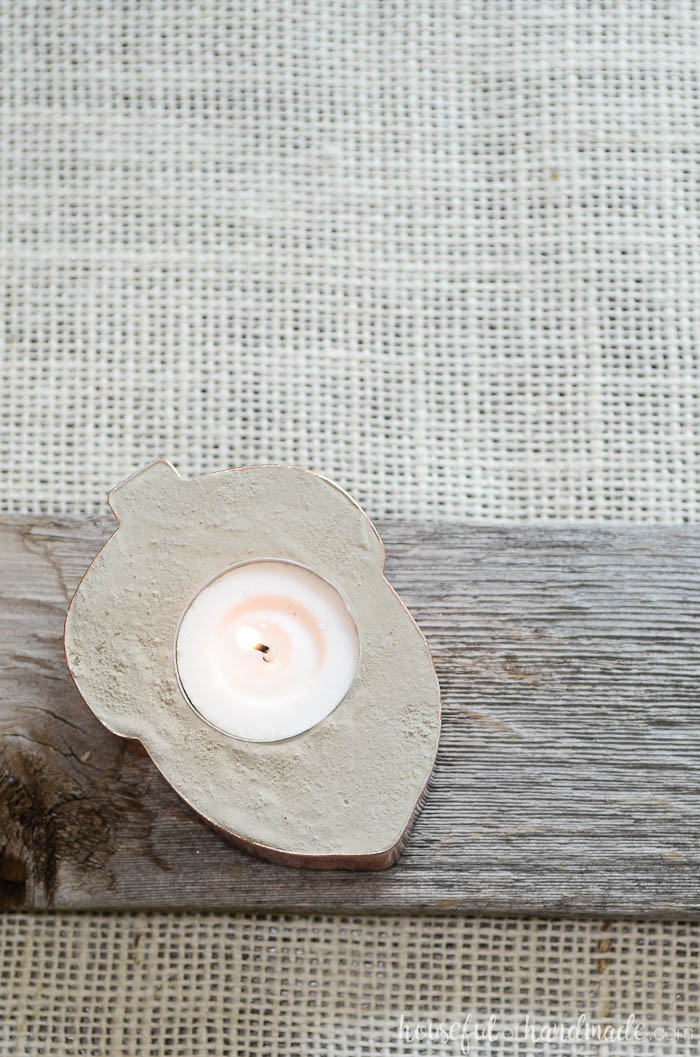 These concrete candle holders are so beautiful. Made out of cookie cutters and tea lights. Get the full tutorial on Housefulofhandmade.com