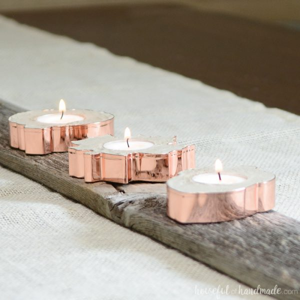 Turn copper cookie cutters into the most beautiful decor for fall! These beautiful copper candle holders will add a bit of sparkle to your decor. Housefulofhandmade.com
