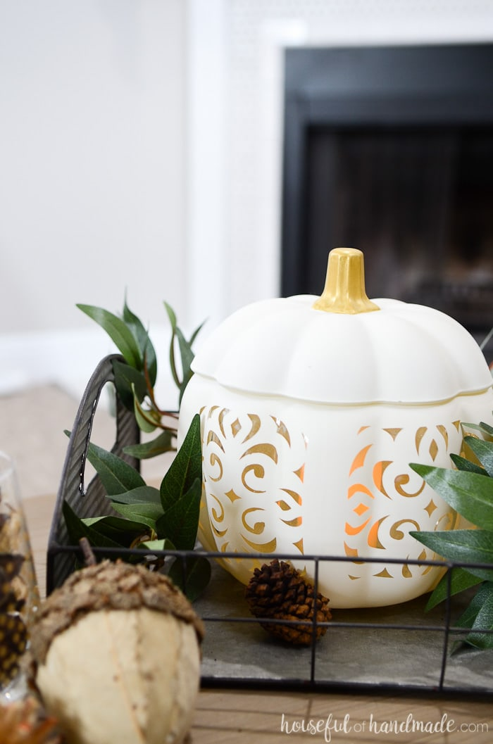 Turn a boring glass pumpkin into a beautiful filigree punched ceramic pumpkin for a high end look! Housefulofhandmade.com