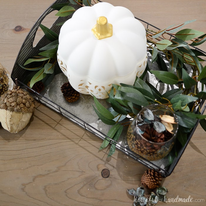 This beautiful filigree punched ceramic pumpkin is the perfect centerpiece for a rustic fall vignette. Housefulofhandmade.com