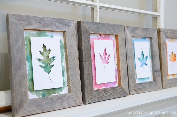 Bright watercolor leaf art is perfect for a non-traditional fall mantel. I love the layers created on this rustic upcycled fall mantel. Housefulofhandmade.com