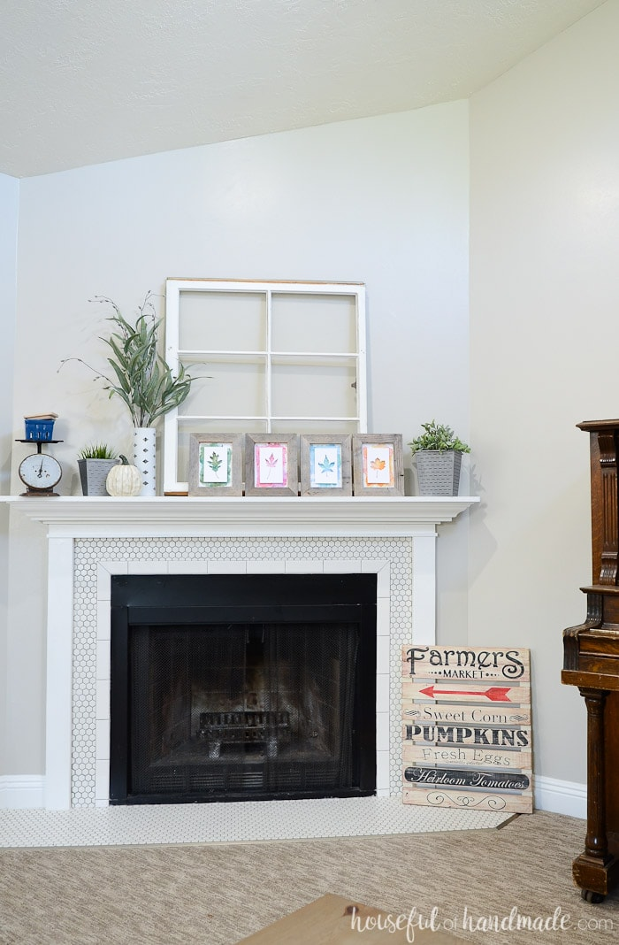 Create a farmhouse in your home for fall with this beautiful rustic upcycled fall mantel. Beautiful layers are created with vintage and found objects. Housefulofhandmade.com