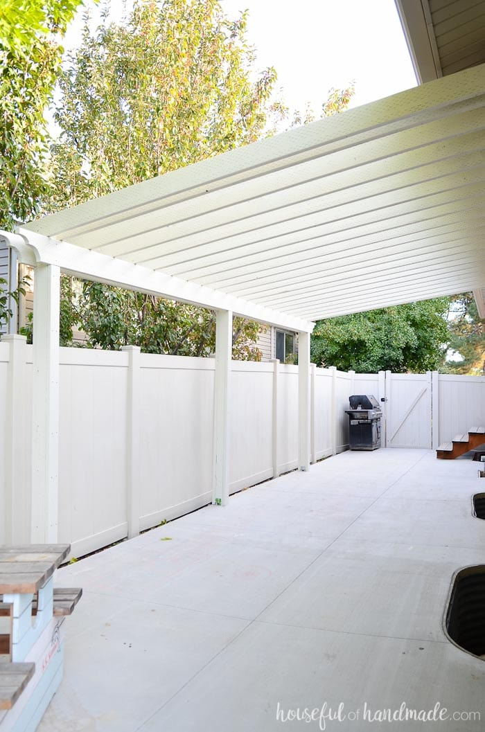 Build a patio pergola attached to the house to extend your living space to the yard. A DIY pergola creates a room outside for entertaining and gathering.