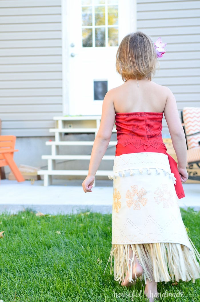 Back of DIY Moana costume with grass skirt and red shirt.
