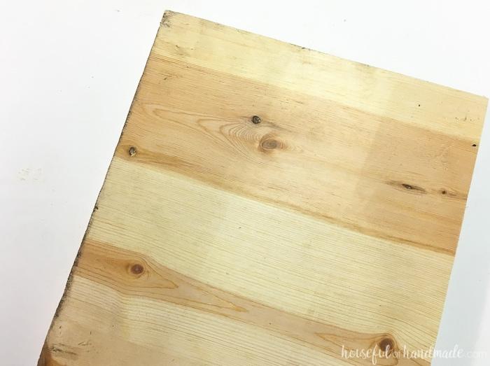 Transform a plain 1x10 board into beautiful tropical wall art. It's perfect for an island oasis. Housefulofhandmade.com