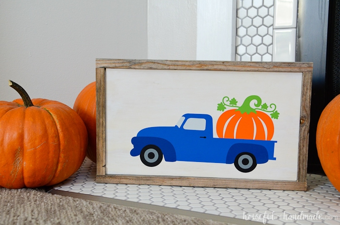 This wood pumpkin sign is perfect to add a bit of whimsy to your rustic fall decor. A scrap of plywood and some reclaimed wood was turned into the perfect frame for the pumpkin truck design. Housefulofhandmade.com
