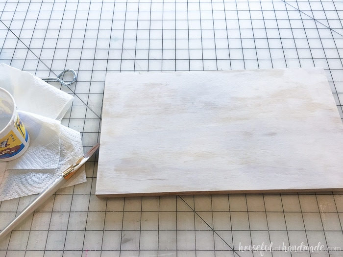 Whitewash the plywood for the rustic pumpkin sign. Housefulofhandmade.com
