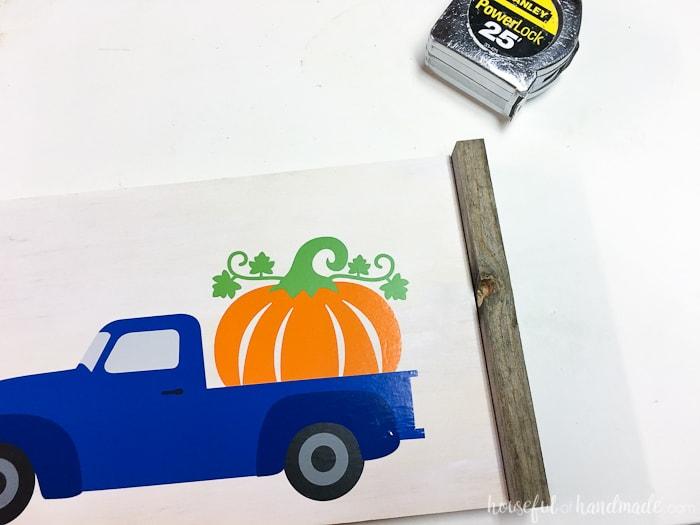 Add a reclaimed wood frame to the wood pumpkin sign. Housefulofhandmade.com