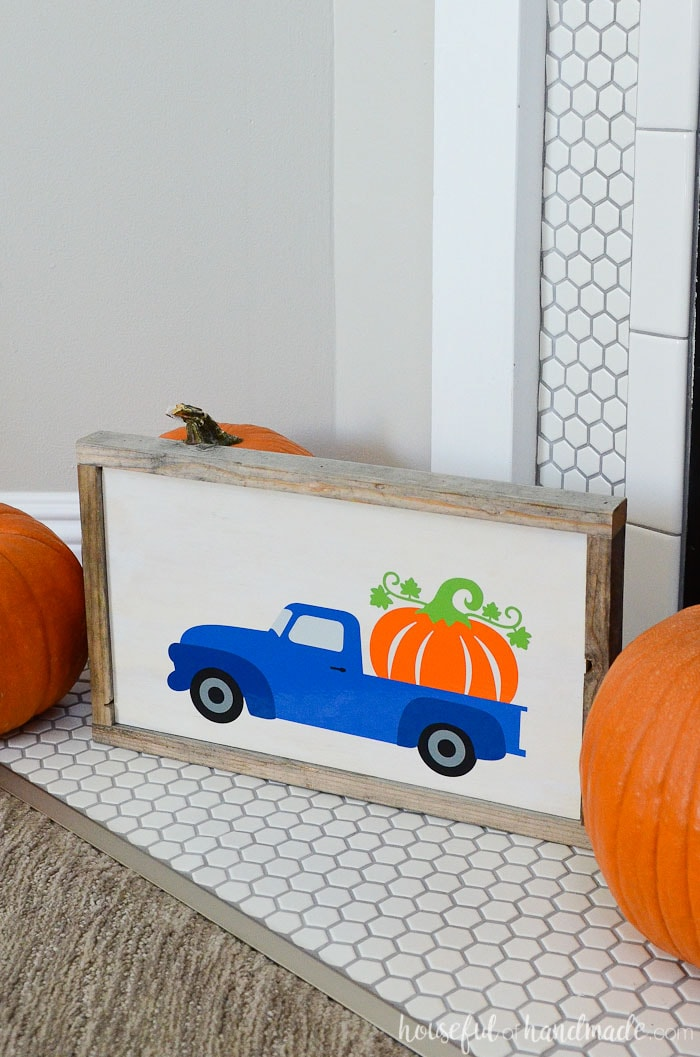 Make an easy wood pumpkin sign from reclaimed wood to celebrate fall. The adorable truck hauling a large pumpkin is perfect for fall decorating. Housefulofhandmade.com