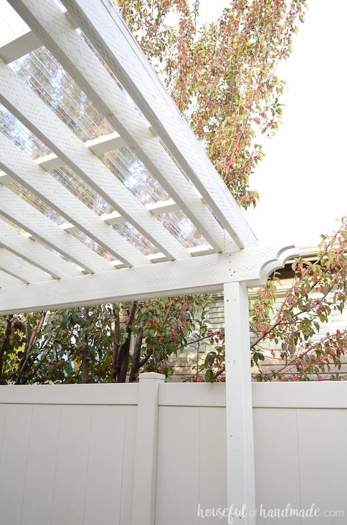 Installing a clear pergola roof was the best decision ever. It has turned  our side yard is a three season patio that we can enjoy in any weather. - Installing A Clear Pergola Roof - Houseful Of Handmade