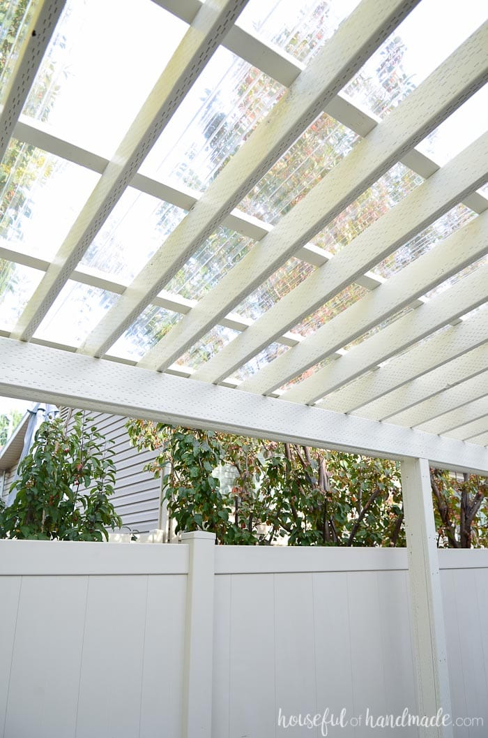 Turn your pergola into a covered porch. You can now use it all year round. See how we installed a clear pergola roof. Housefulofhandmade.com