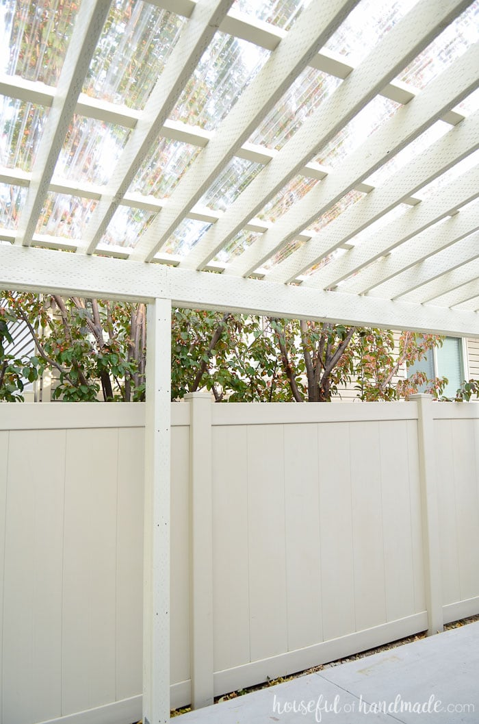 We added a clear pergola roof to the pergola. Now it's the perfect place to enjoy family gatherings no matter the weather. Housefulofhandmade.com