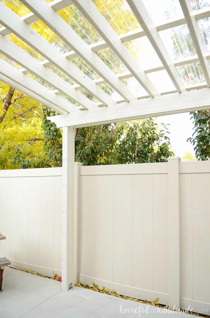 This pergola is gorgeous! See the complete plans for the DIY pergola and clear pergola roof at Housefulofhandmade.com